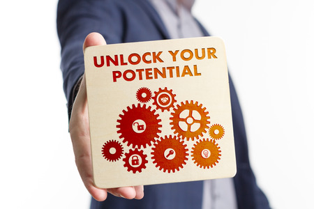 The concept of business, technology, the Internet and the network. Young businessman showing inscription: Unlock your potential Stock Photo