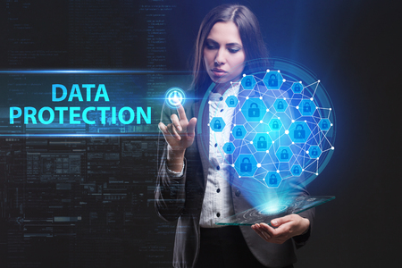 The concept of business, technology, the Internet and the network. A young entrepreneur working on a virtual screen of the future and sees the inscription: Data protection