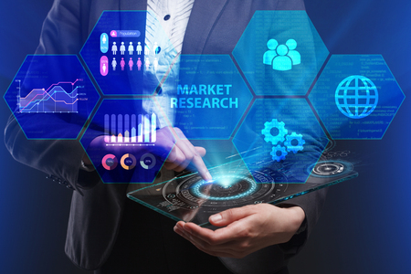 The concept of business, technology, the Internet and the network. A young entrepreneur working on a virtual screen of the future and sees the inscription: Market research Lizenzfreie Bilder
