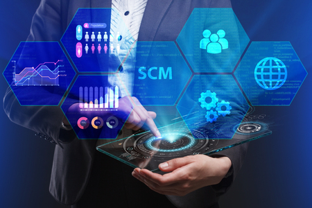 The concept of business, technology, the Internet and the network. A young entrepreneur working on a virtual screen of the future and sees the inscription: SCM