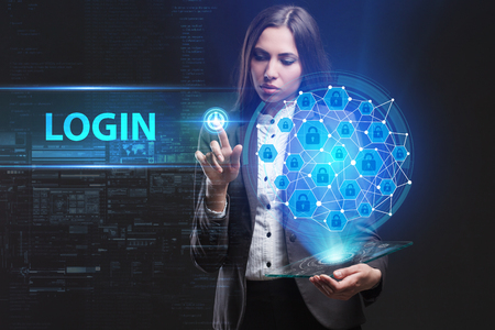 The concept of business, technology, the Internet and the network. A young entrepreneur working on a virtual screen of the future and sees the inscription: Login Lizenzfreie Bilder
