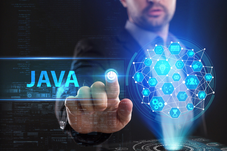 The concept of business, technology, the Internet and the network. A young entrepreneur working on a virtual screen of the future and sees the inscription: Java