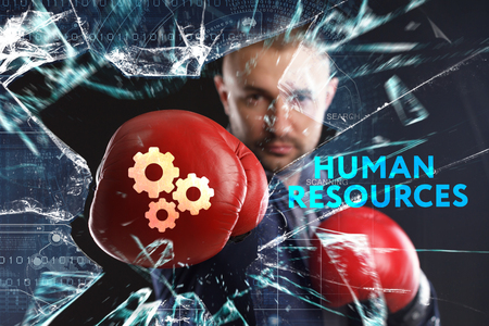 The concept of business, technology, the Internet and the network. A young businessman overcomes difficulties and sees an inscription: Human resources Stock Photo