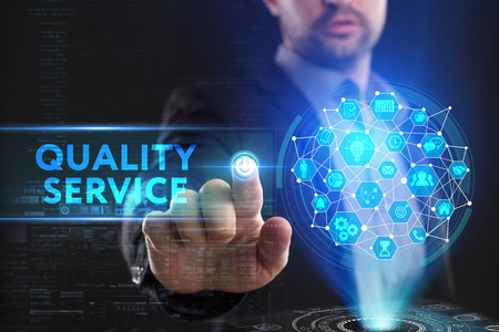 The concept of business, technology, the Internet and the network. A young entrepreneur working on a virtual screen of the future and sees the inscription: Quality service 스톡 콘텐츠