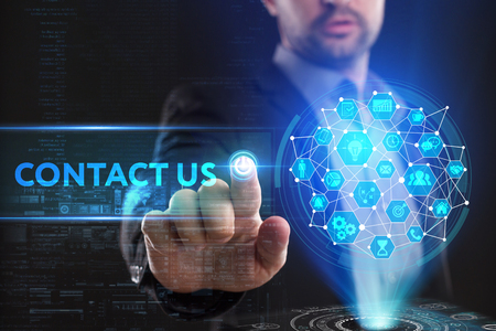 The concept of business, technology, the Internet and the network. A young entrepreneur working on a virtual screen of the future and sees the inscription: Contact us 스톡 콘텐츠