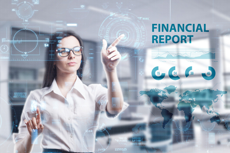The concept of business, technology, the Internet and the network. A young entrepreneur working on a virtual screen of the future and sees the inscription: Financial report