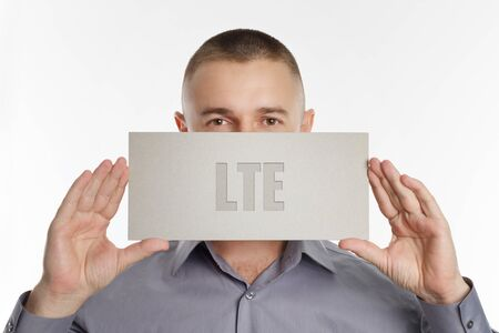 The concept of business, technology, the Internet and the network. Young businessman showing inscription: LTE