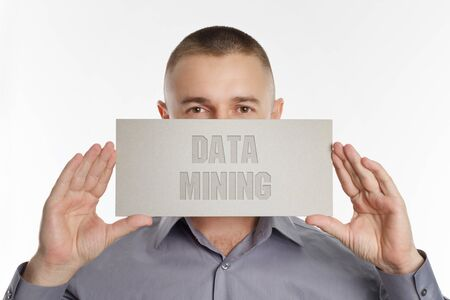 The concept of business, technology, the Internet and the network. Young businessman showing inscription: Data mining Stock Photo