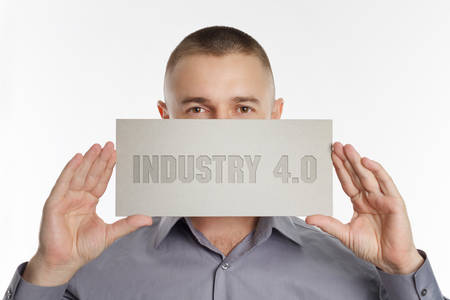 The concept of business, technology, the Internet and the network. Young businessman showing inscription: Industry 4.0