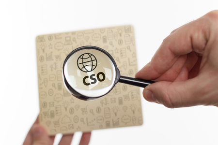 The concept of business, technology, the Internet and the network. Young businessman showing inscription: CSO Stock Photo