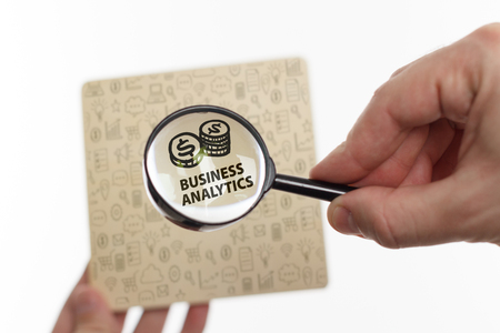 The concept of business, technology, the Internet and the network. Young businessman showing inscription: Business analytics