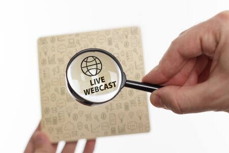The concept of business, technology, the Internet and the network. Young businessman showing inscription: Live webcast