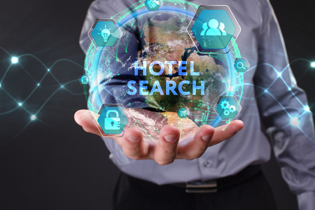 The concept of business, technology, the Internet and the network. A young entrepreneur working on a virtual screen of the future and sees the inscription: Hotel search