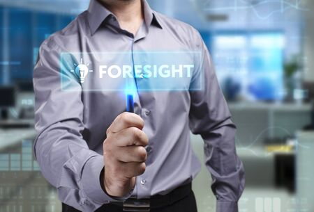 The concept of business, technology, the Internet and the network. A young entrepreneur working on a virtual screen of the future and sees the inscription: Foresight