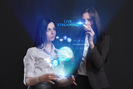 The concept of business, technology, the Internet and the network. A team of business women working on the virtual screen of the future and see the inscription: Live streaming Imagens - 92502209
