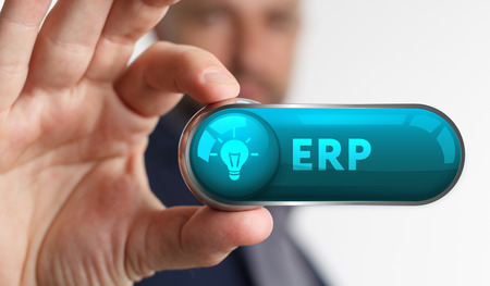 The concept of business, technology, the Internet and the network. A young entrepreneur working on a virtual screen of the future and sees the inscription: ERP Stock Photo