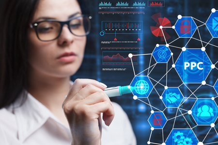 The concept of business, technology, the Internet and the network. A young entrepreneur working on a virtual screen of the future and sees the inscription: PPC Stock Photo