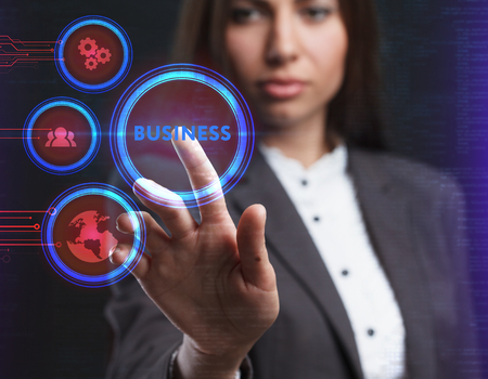 The concept of business, technology, the Internet and the network. A young entrepreneur working on a virtual screen of the future and sees the inscription: Business Stock fotó
