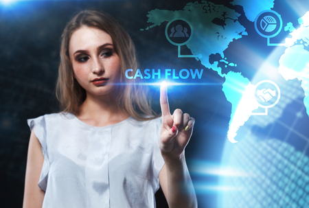 The concept of business, technology, the Internet and the network. A young entrepreneur working on a virtual screen of the future and sees the inscription: Cash flow