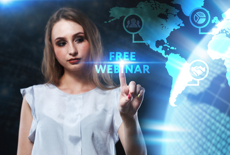 The concept of business, technology, the Internet and the network. A young entrepreneur working on a virtual screen of the future and sees the inscription: Free webinar Stock Photo