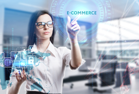 The concept of business, technology, the Internet and the network. A young entrepreneur working on a virtual screen of the future and sees the inscription: E-commerce