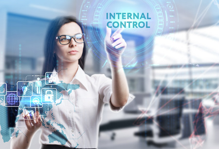 The concept of business, technology, the Internet and the network. A young entrepreneur working on a virtual screen of the future and sees the inscription: Internal control
