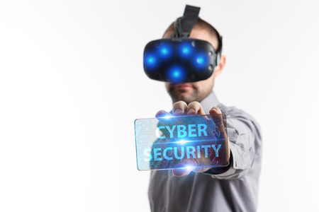 Business, Technology, Internet and network concept. Young businessman working in virtual reality glasses sees the inscription: Cyber security Stock Photo