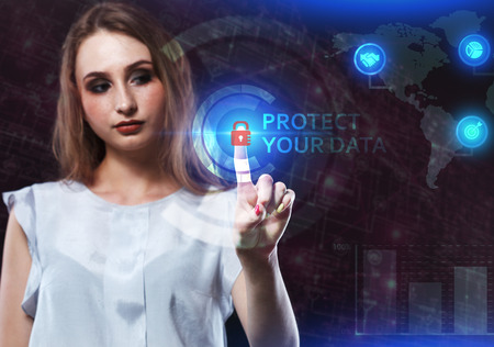 The concept of business, technology, the Internet and the network. A young entrepreneur working on a virtual screen of the future and sees the inscription: Protect your data Banque d'images