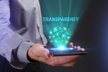 The concept of business, technology, the Internet and the network. A young entrepreneur working on a virtual screen of the future and sees the inscription: Transparency Stockfoto