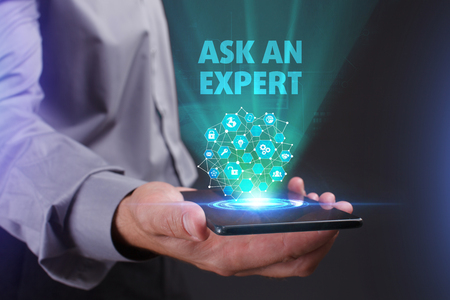 The concept of business, technology, the Internet and the network. A young entrepreneur working on a virtual screen of the future and sees the inscription: Ask an expert Stockfoto