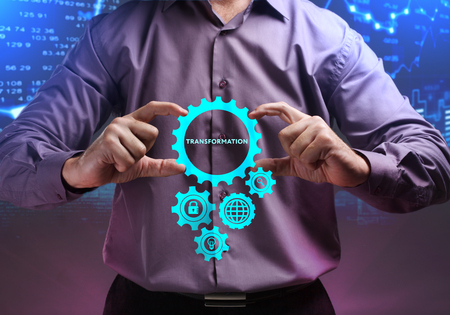 The concept of business, technology, the Internet and the network. A young entrepreneur working on a virtual screen of the future and sees the inscription: Transformation Stock Photo - 104480503