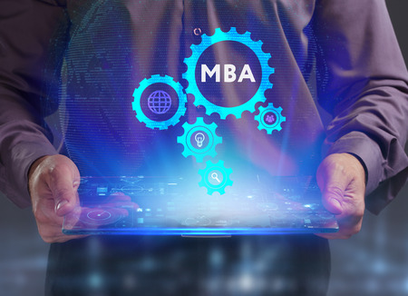 The concept of business, technology, the Internet and the network. A young entrepreneur working on a virtual screen of the future and sees the inscription: MBA