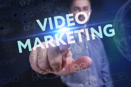 The concept of business, technology, the Internet and the network. A young entrepreneur working on a virtual screen of the future and sees the inscription: Video marketing Stock Photo - 104480507