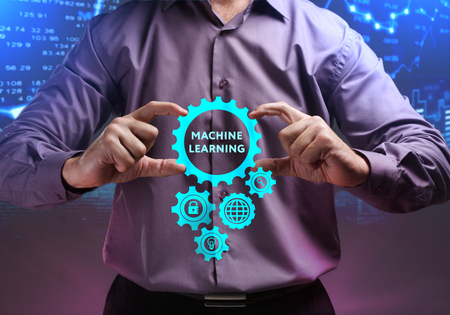 The concept of business, technology, the Internet and the network. A young entrepreneur working on a virtual screen of the future and sees the inscription: Machine learning Stock Photo - 104480509