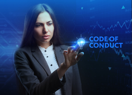 The concept of business, technology, the Internet and the network. A young entrepreneur working on a virtual screen of the future and sees the inscription: Code of conduct 写真素材