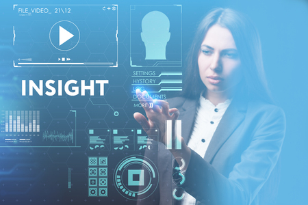 The concept of business, technology, the Internet and the network. A young entrepreneur working on a virtual screen of the future and sees the inscription: Insight 写真素材