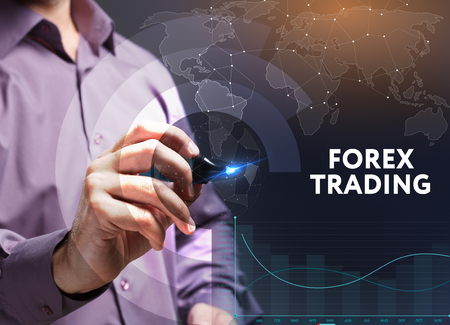 The concept of business, technology, the Internet and the network. A young entrepreneur working on a virtual screen of the future and sees the inscription: Forex trading