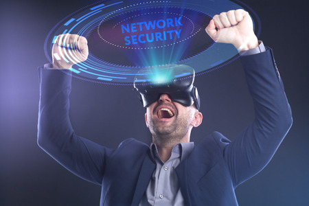 The concept of business, technology, the Internet and the network. A young entrepreneur working on a virtual screen of the future and sees the inscription: Network security Stock Photo