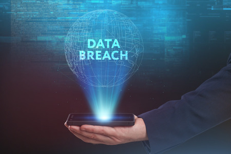 The concept of business, technology, the Internet and the network. A young entrepreneur working on a virtual screen of the future and sees the inscription: Data breach Stock Photo