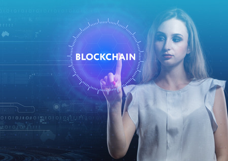 The concept of business, technology, the Internet and the network. A young entrepreneur working on a virtual screen of the future and sees the inscription: blockchain