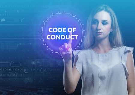 The concept of business, technology, the Internet and the network. A young entrepreneur working on a virtual screen of the future and sees the inscription: Code of conduct Stock Photo
