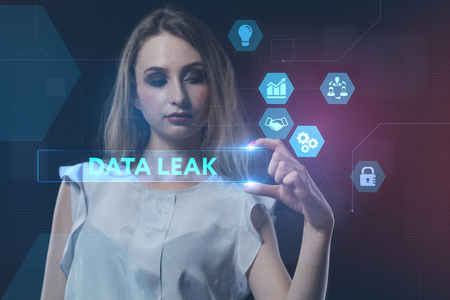 The concept of business, technology, the Internet and the network. A young entrepreneur working on a virtual screen of the future and sees the inscription: Data leak Фото со стока