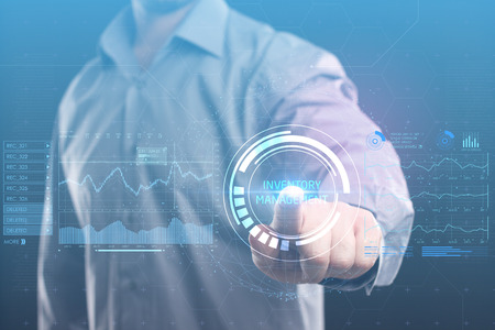 The concept of business, technology, the Internet and the network. A young entrepreneur working on a virtual screen of the future and sees the inscription: Inventory management Stock Photo