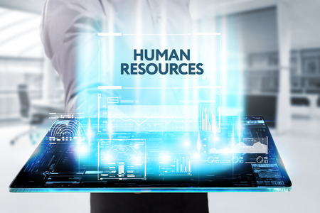 The concept of business, technology, the Internet and the network. A young entrepreneur working on a virtual screen of the future and sees the inscription: Human resources 写真素材