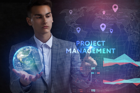 The concept of business, technology, the Internet and the network. A young entrepreneur working on a virtual screen of the future and sees the inscription: Project management 스톡 콘텐츠