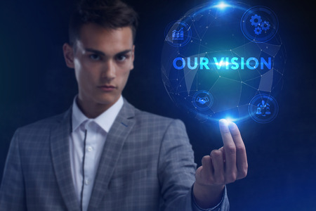 The concept of business, technology, the Internet and the network. A young entrepreneur working on a virtual screen of the future and sees the inscription: Our vision Фото со стока