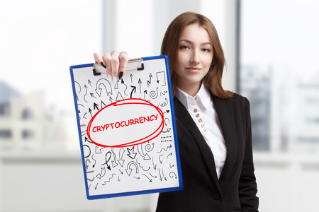 Business, technology, internet and networking concept. Young entrepreneur showing keyword: Cryptocurrency
