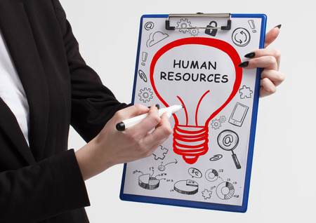 Business, technology, internet and networking concept. Young entrepreneur showing keyword: Human resources
