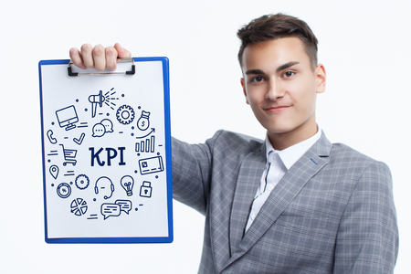 Business, technology, internet and networking concept. Young entrepreneur showing keyword: KPI
