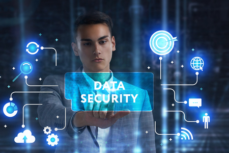 The concept of business, technology, the Internet and the network. A young entrepreneur working on a virtual screen of the future and sees the inscription: Data security Фото со стока